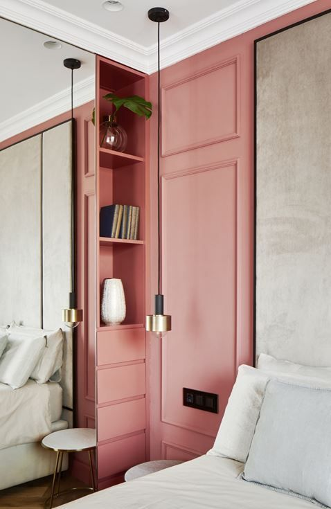 Pink bedroom with bedside ceiling lights in brass | houseof.com