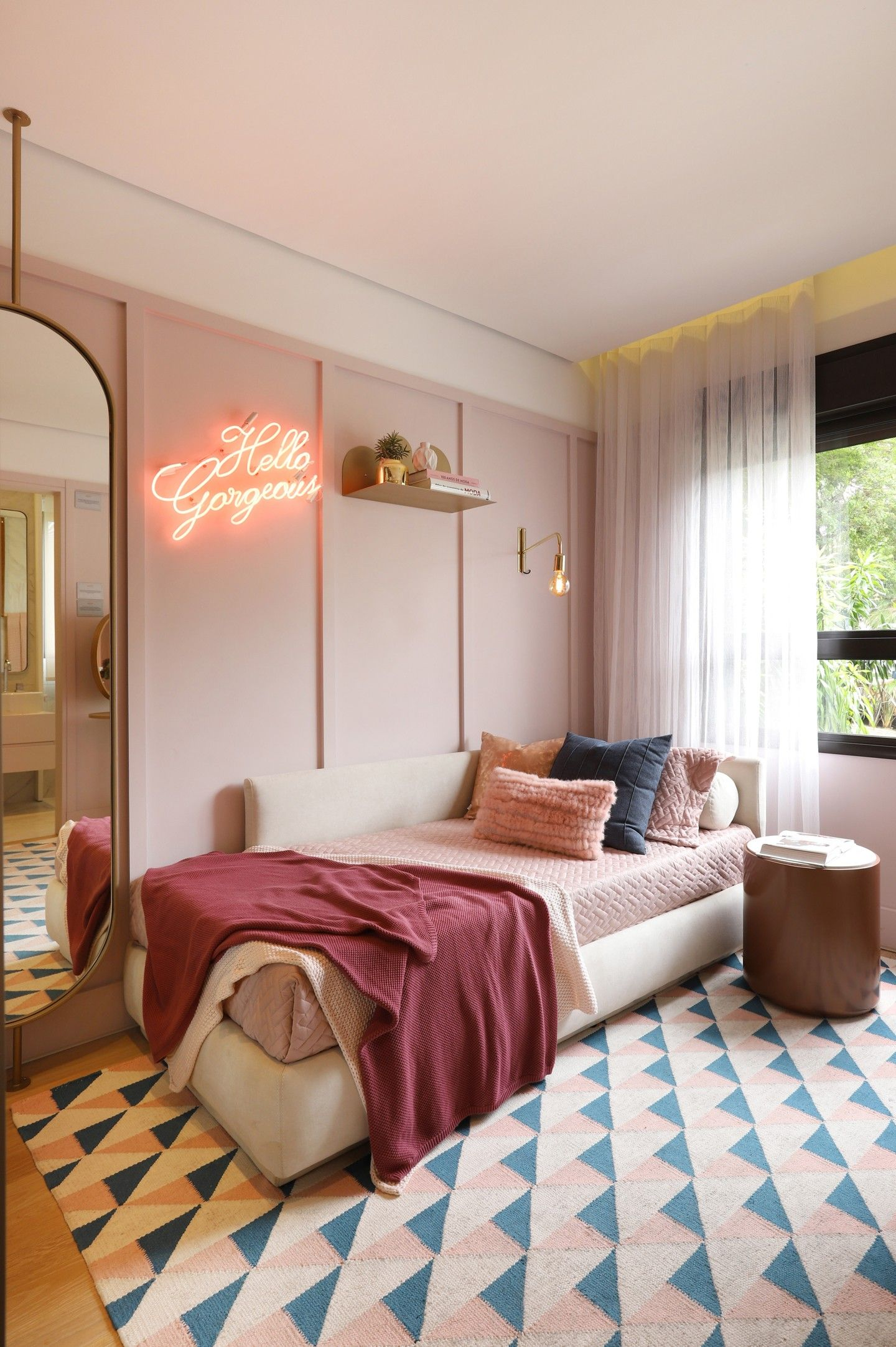 Pink bedroom with LED bedside lighting