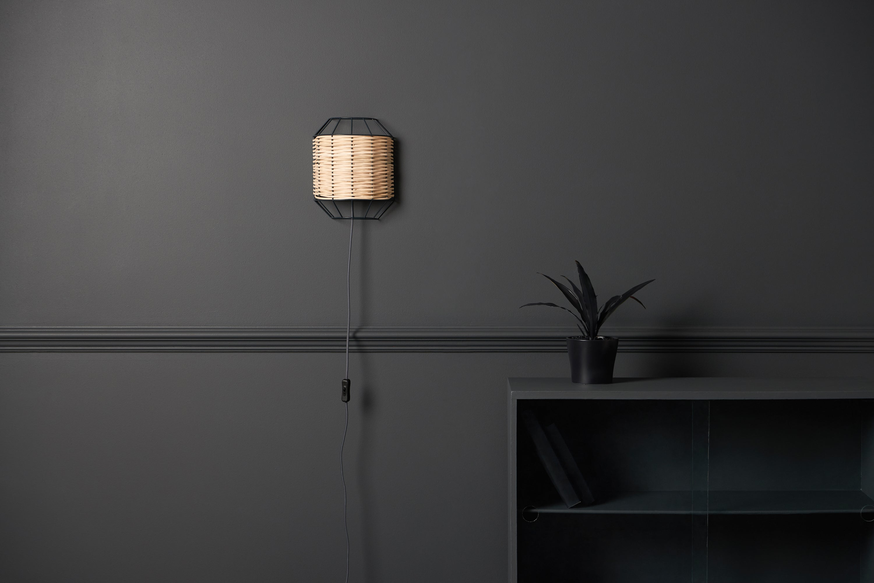 rattan wall light in charcoal | houseof.com