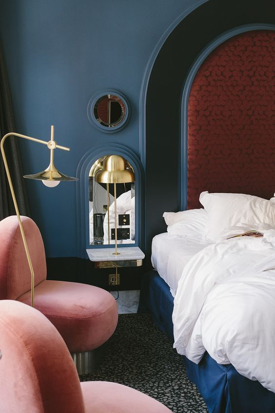 Blue bedroom with brass bedside lights | houseof.com