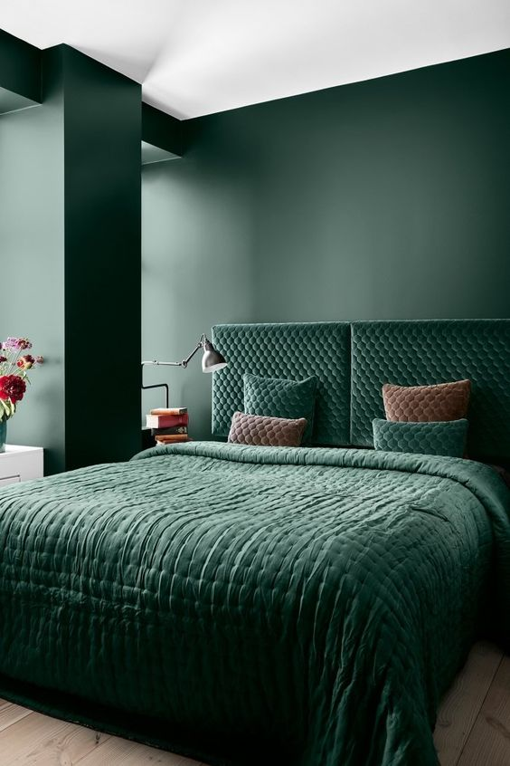 Green bedroom with brass wall light bedside light | houseof.com