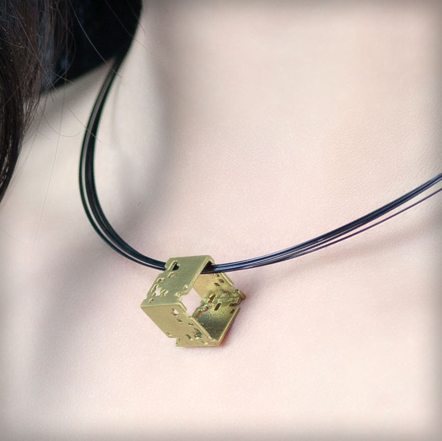 Necklace with small golden cube
