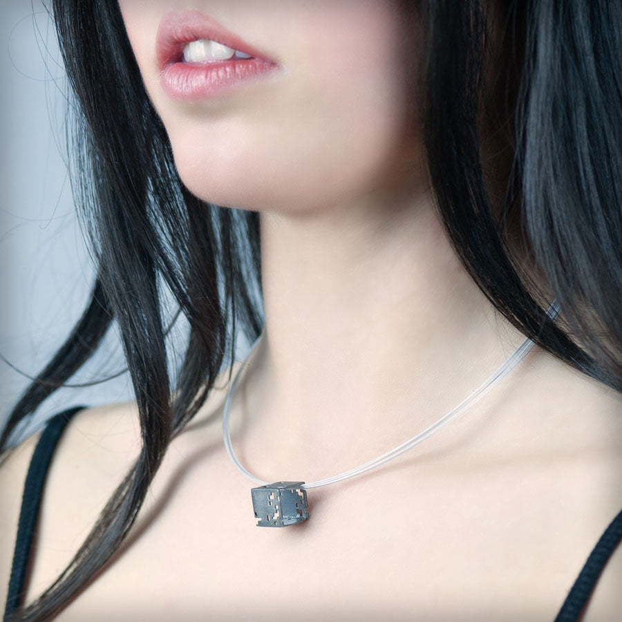 Necklace with small black cube