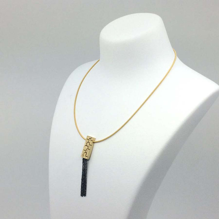 Textura golden necklace with chains