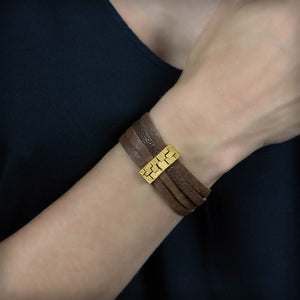 Small golden leather bracelet