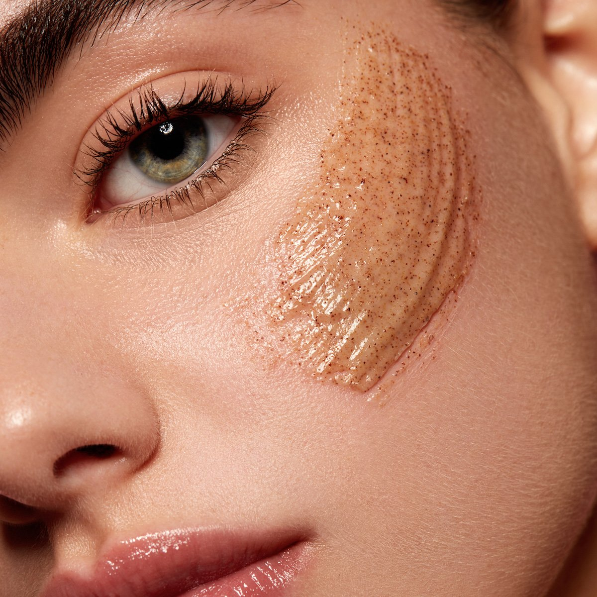 Model using Kylie Skin Walnut Face Scrub by Kylie Jenner