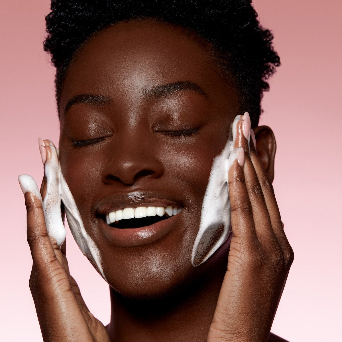 Model using Kylie Skin Foaming Face Wash by Kylie Jenner