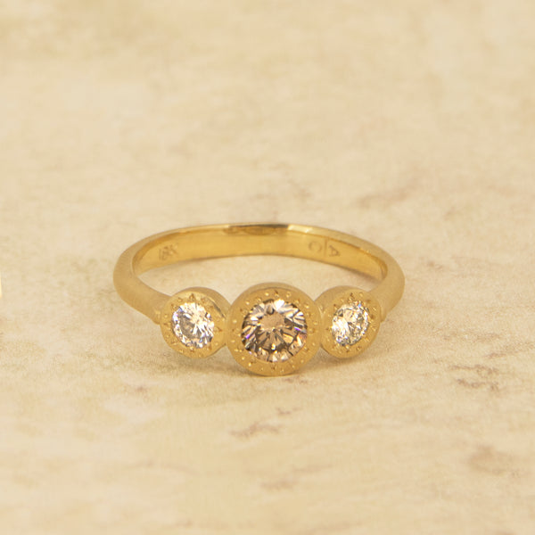 ETCHED ROUND THREE STONE RING