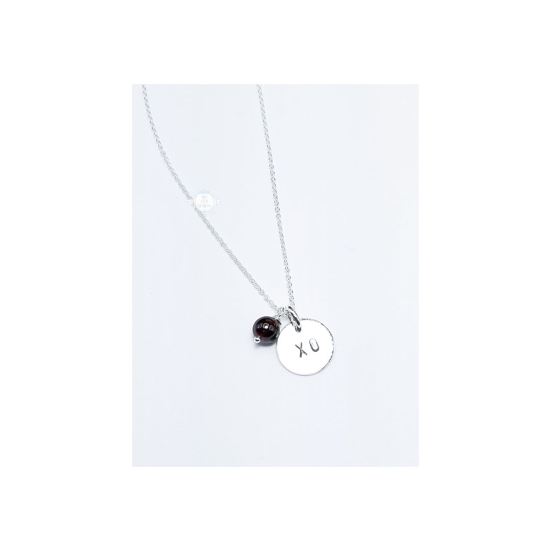 LOVE LETTERS ROUND CHARM NECKLACE WITH XO & GARNET