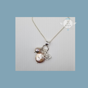 INFINITY HEART CHARM NECKLACE WITH PEACH FRESHWATER PEARLS