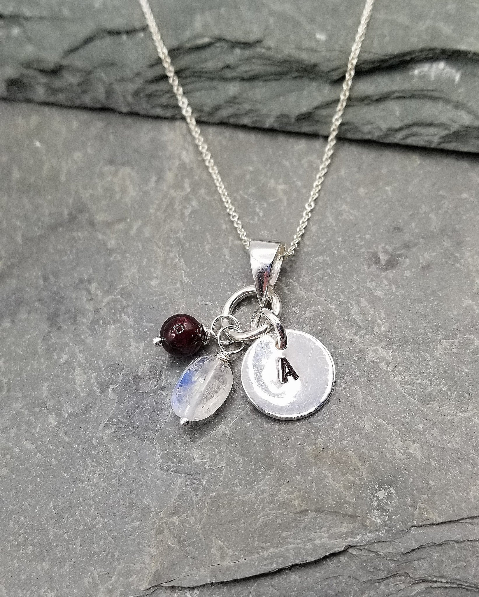LOVE LETTERS ROUND CHARM NECKLACE WITH GARNET & MOONSTONE