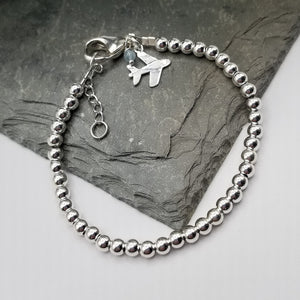 SWEET GEMS STERLING SILVER BRACELET WITH AIRPLANE CHARM
