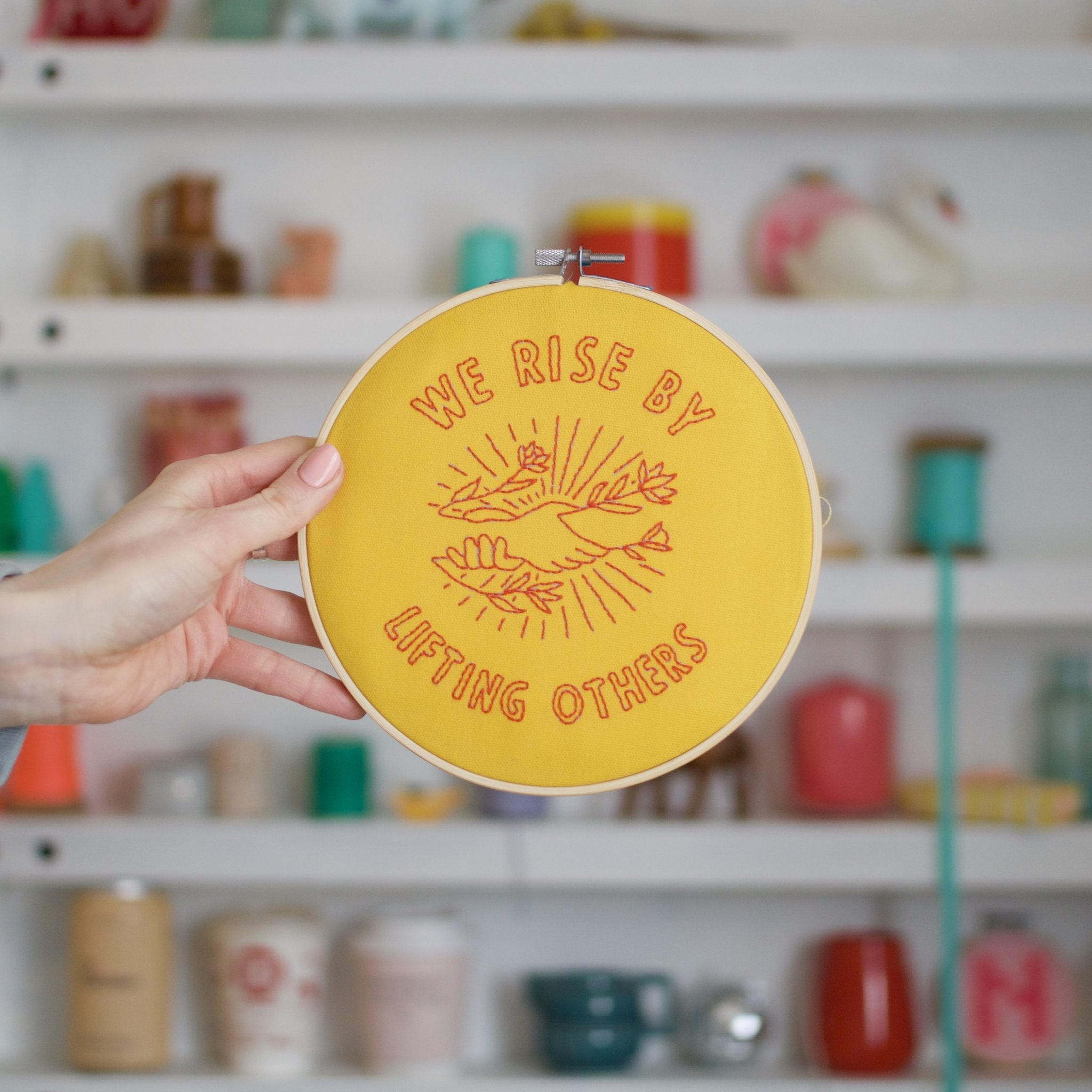 We Rise By Lifting Others Yellow Embroidery Hoop