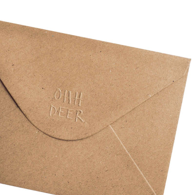 Close up corner of brown Kraft envelope with Ohh Deer logo