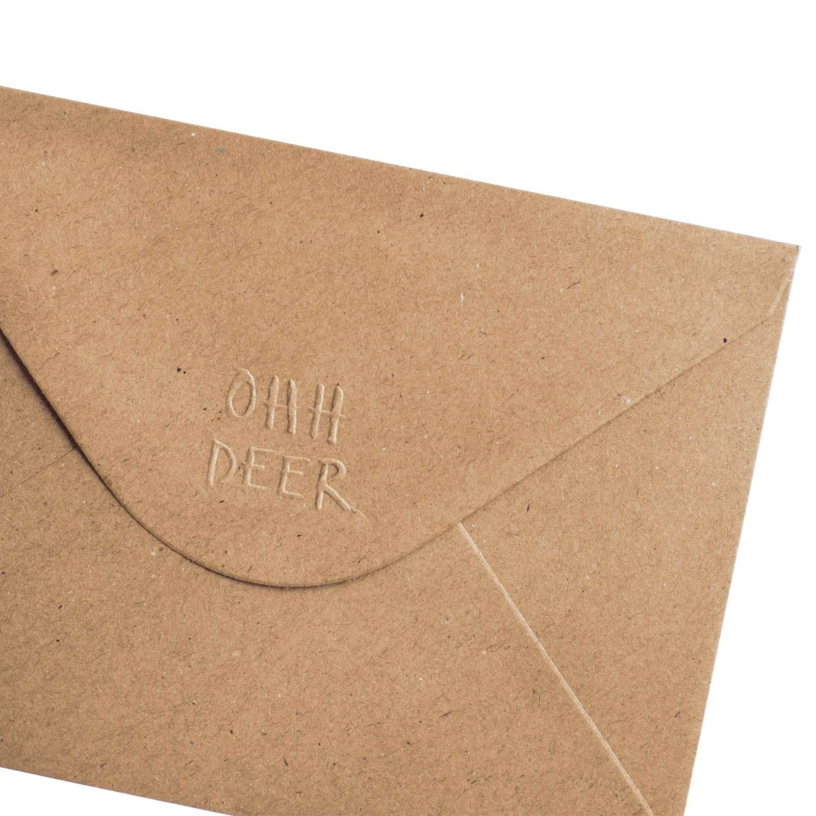 Brown envelope close up of corner with Ohh Deer logo on flap