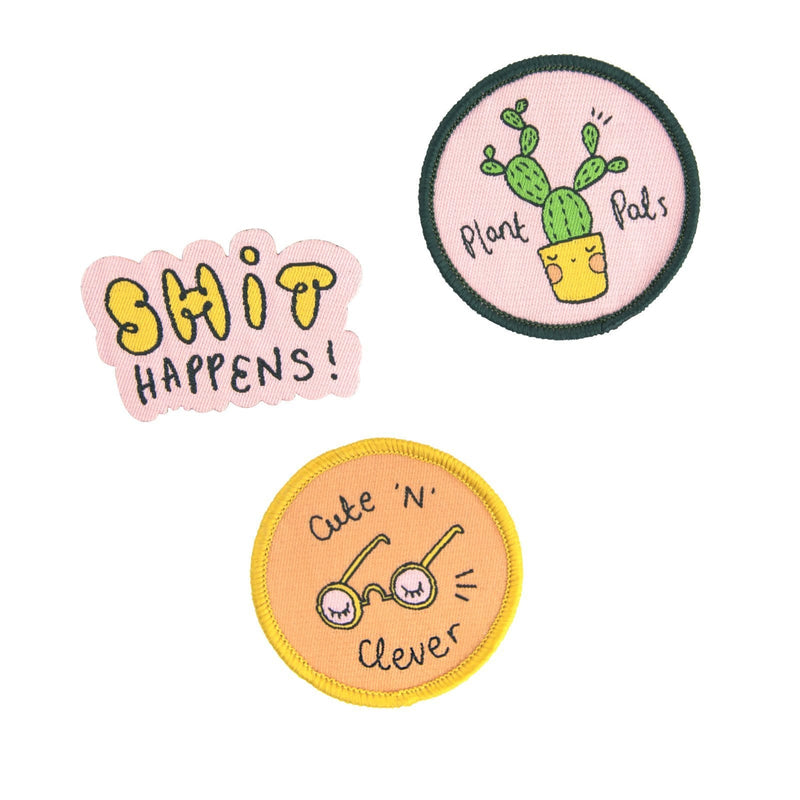 Three fabric patches in pastel pink, blue, orange and yellow with positive quotes