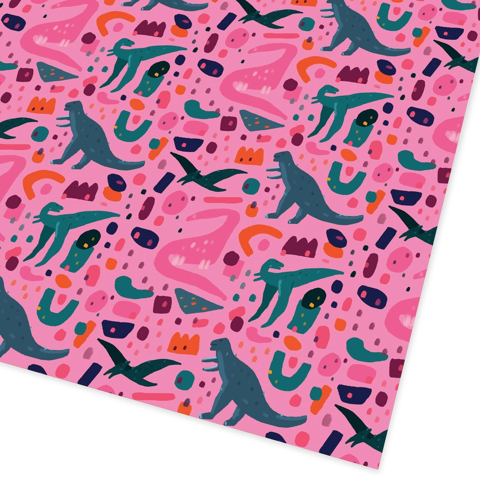 Pink gift wrap with green, blue and pink dinosaurs printed on