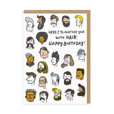 White birthday card with illustrated males faces with hair on head and black text
