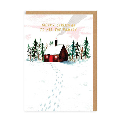 Christmas Card with cabin in snow illustration with trees, and gold writing