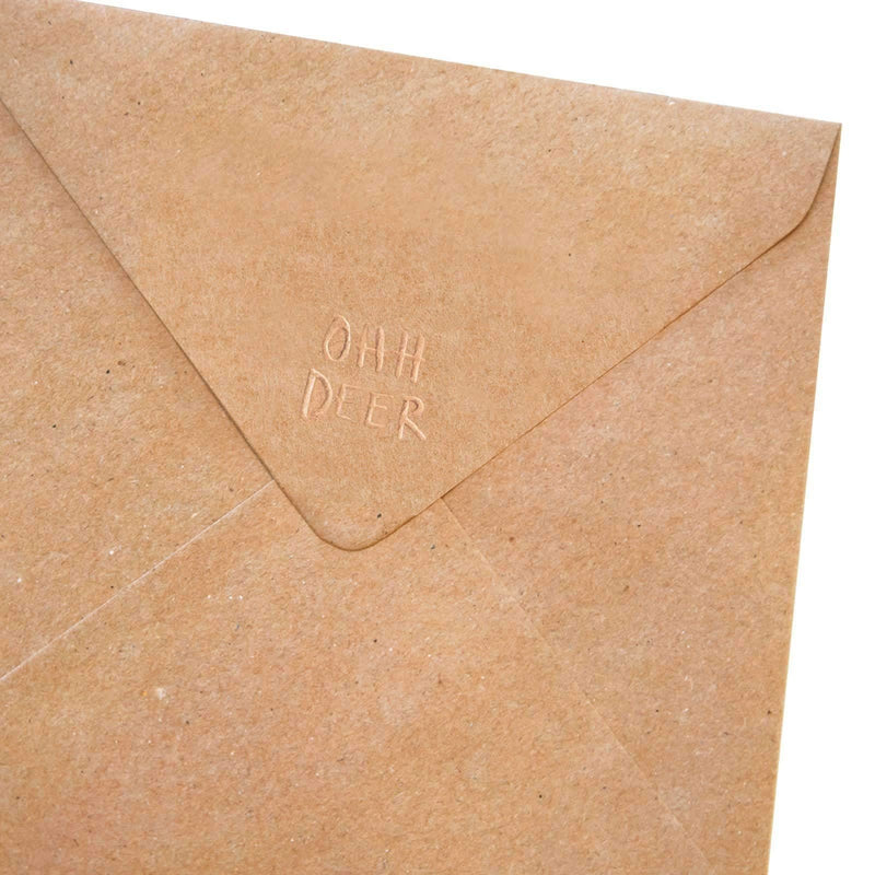 Back of brown kraft paper envelope with Ohh Deer logo embossed