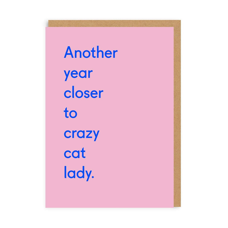 Pink birthday card with blue quote saying 'Another Year Closer to Crazy Cat Lady'