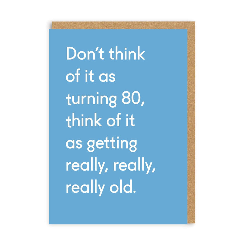 Blue greetings card with white text for 80th birthday, brown envelope behind