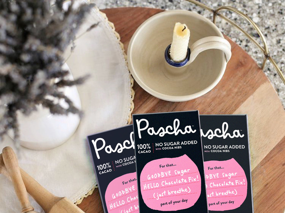 Pascha 100% Cacao Bars on a table with lavender and a candle