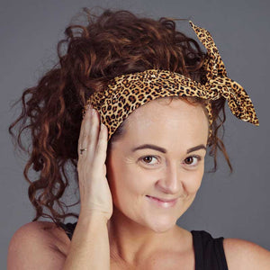 Model wearing an AntiCraft do rag, a wired head wrap in the twist style - wire hair accessories that fix bad hair days.