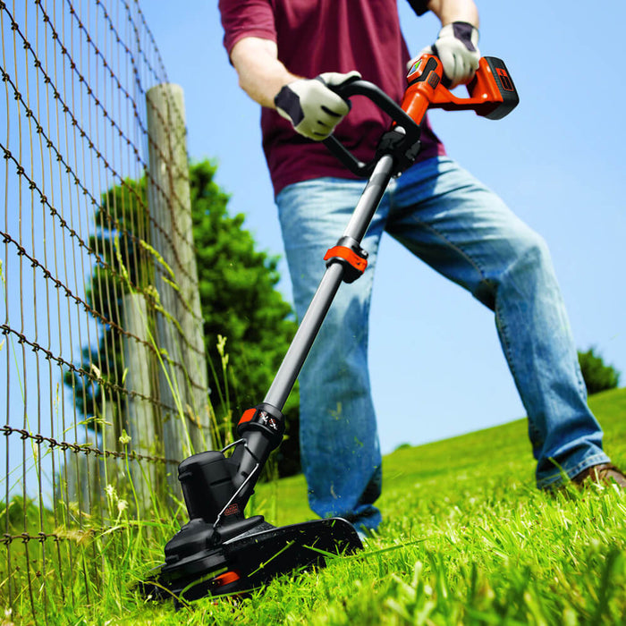 using the Black and Decker LST136R String Trimmer on the front lawn