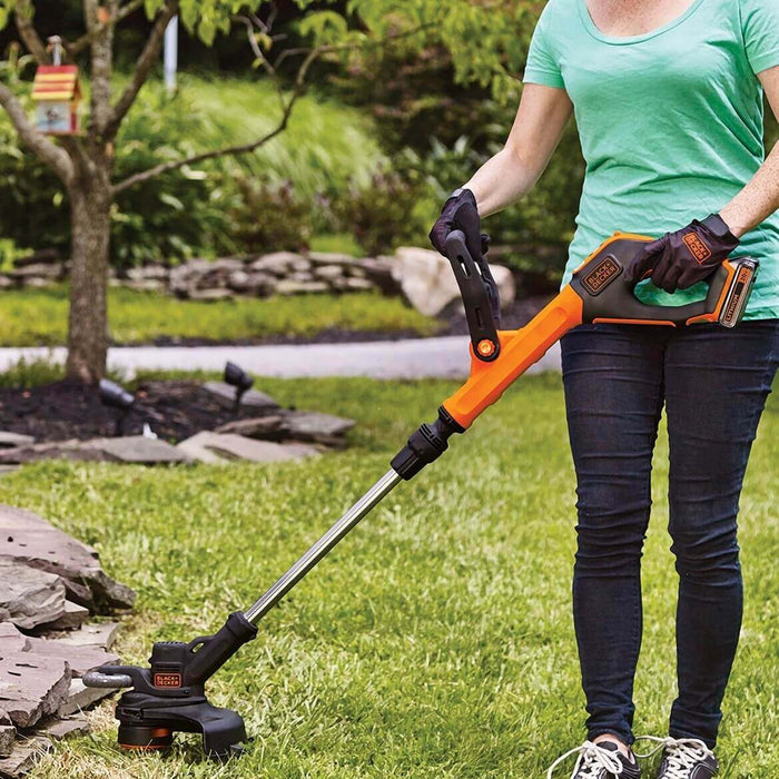 Black and Decker LST522 String Trimmer being used in the front yard