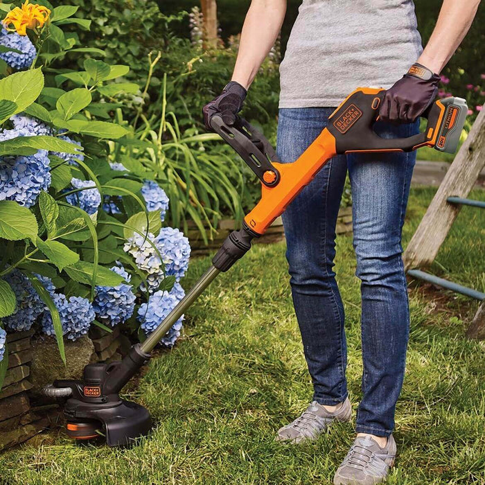 person using the Black and Decker LSTE523 String Trimmer in the garden