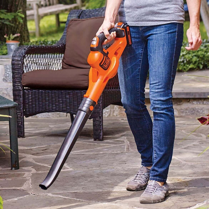 person using the Black and Decker LSW321 Leaf Blower on the patio