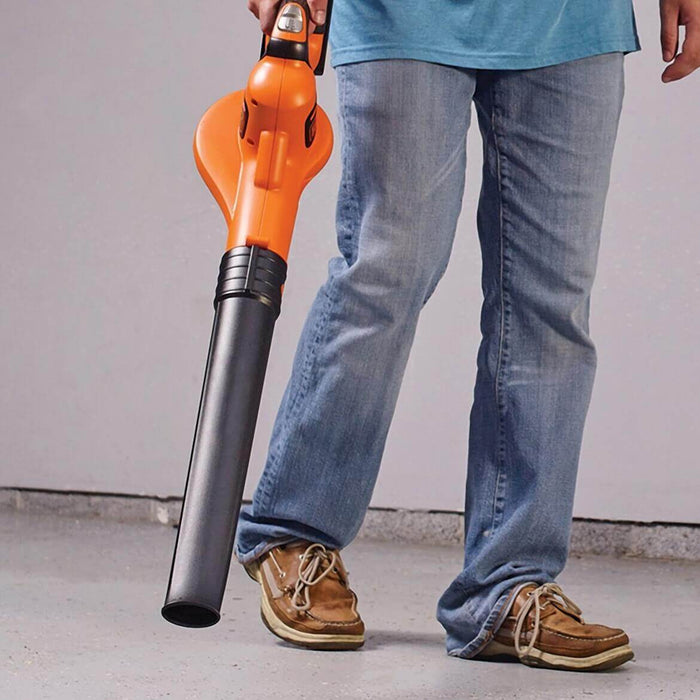 person using the Black and Decker LSW321 Leaf Blower in the garage