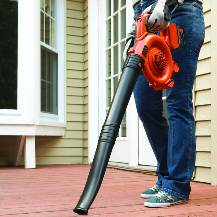 person using the Black and Decker LSW36 Leaf Blower