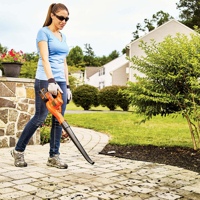 woman using the Black and Decker LSW40C Sweeper Blower