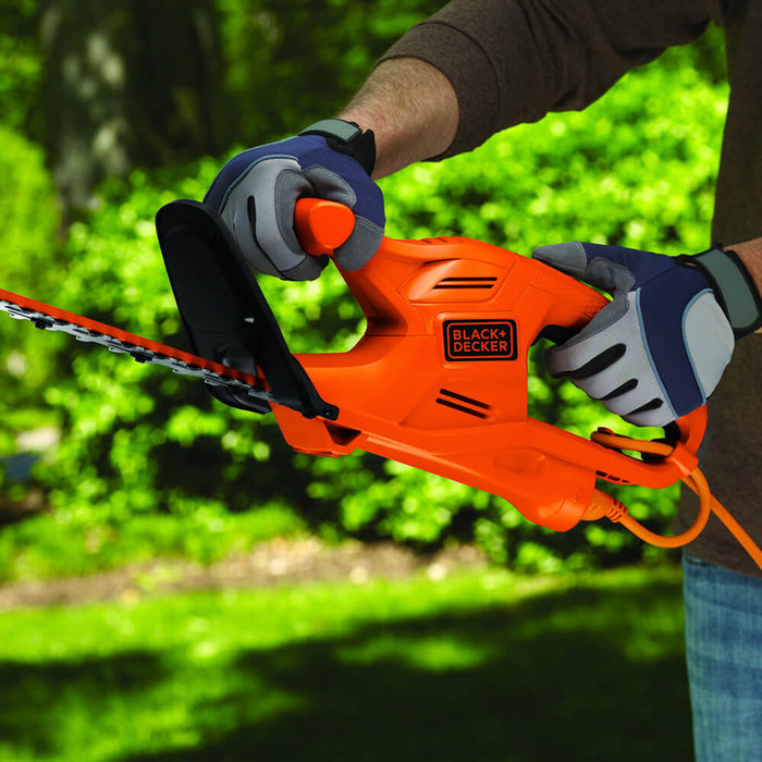 Side profile view of TR117 hedge trimmer in use
