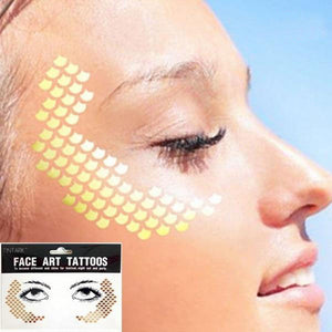 Golden Mermaid Face Tattoo