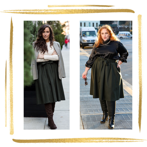 woman on left wears plaid light brown jacket over ivory sweater with olive green knee length skirt with 3 pleats and paperbag pleating at waistline and matching belt tied in a bow. womn on right wears same skirt with flowy black blouse and gold chunky necklace
