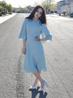 size 2 woman wears Soft Flared Dress with Gathered Neckline and Voluminous Sleeves