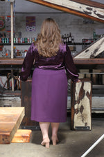 back view of size 18 woman wearing Pencil Skirt with Decorative Zippers
