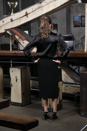 back view of size 2 woman wearing Pencil Skirt with Decorative Zippers