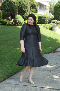 size 10 woman wears A-line dress with side ruffles