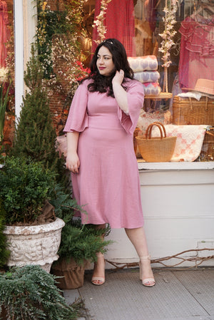 Size 10 woman wears Soft Flared Dress with Gathered Neckline and Voluminous Sleeves