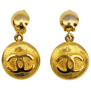 Vintage Chanel gold tone round CC clip on earrings