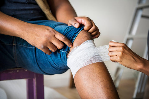 Image source: https://www.pexels.com/photo/person-putting-bandages-on-another-person-s-knee-1385747/