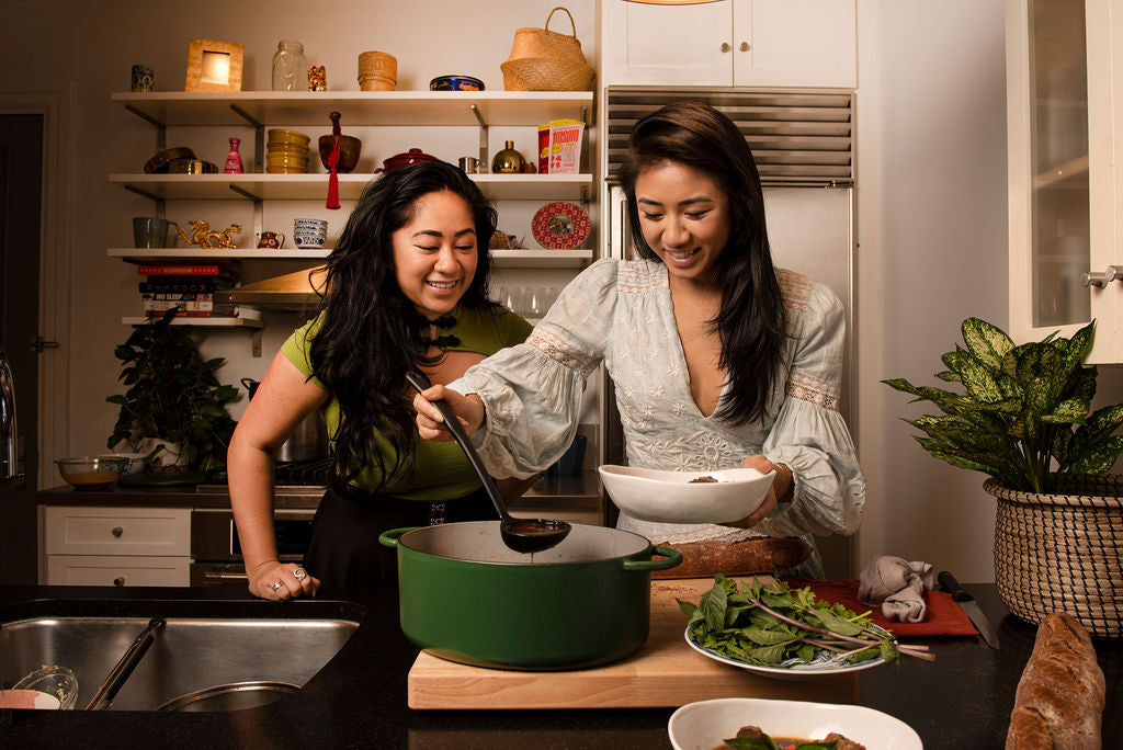 The Pham sisters at home in the kitchen.