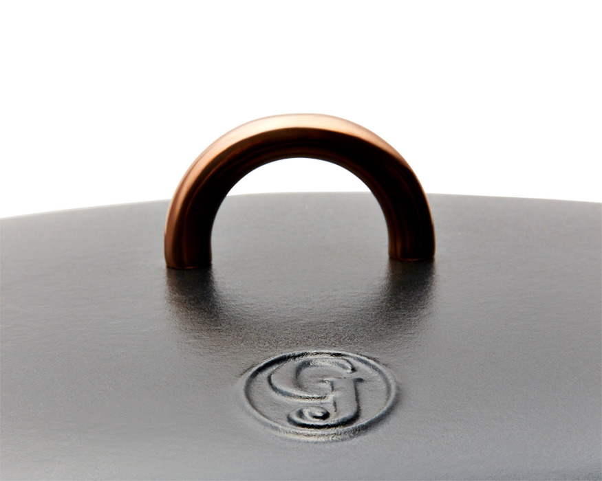 Enameled cast-iron Dutch oven in pepper black - lid handle close-up