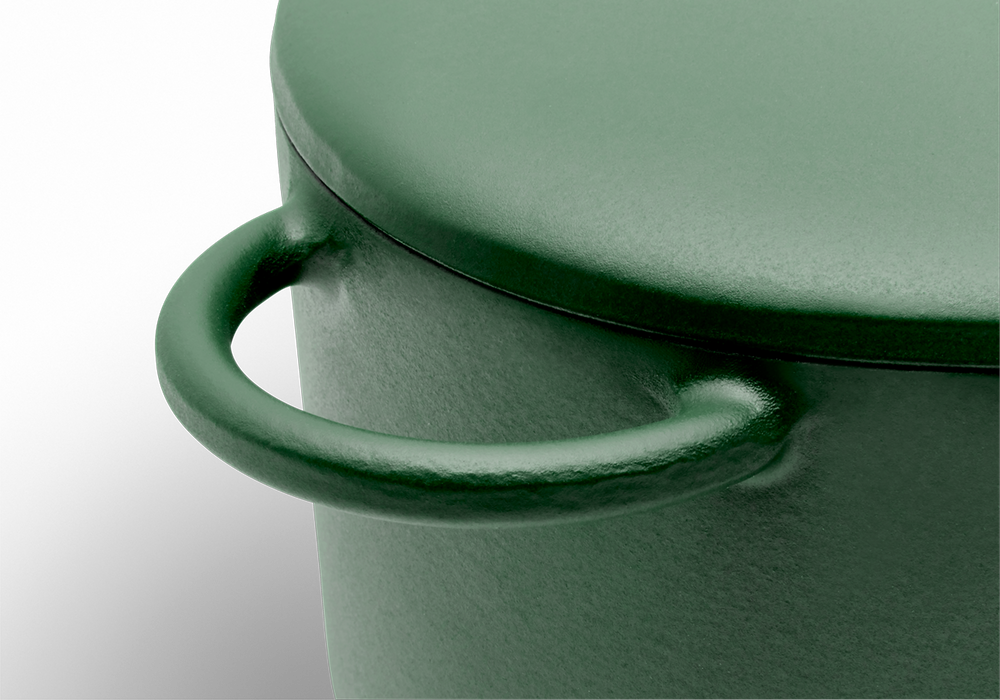 Enameled cast-iron Dutch oven in broccoli green - handle close-up