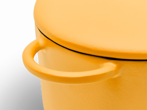 Enameled cast-iron Dutch oven in mustard yellow - handle close-up