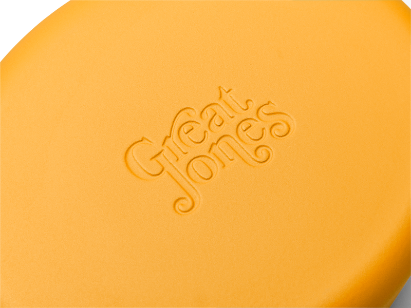 Enameled cast-iron Dutch oven in mustard yellow - logo close-up